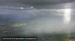Rain showers backlit to Galty Mountains from Cashel